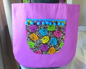 Shoulder bag - Purple with Multicoloured Roses on Black  pocket with 20 mm blue  Pompoms. Fully lined with internal pocket.