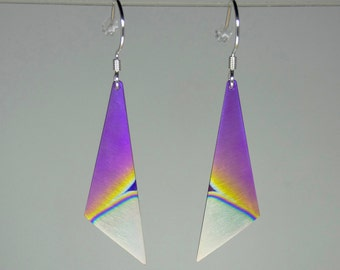 Pair of anodized titanium and silver swinging earrings 42 mm in length. Titanium jewelry. Colourfull jewelry.