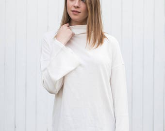 Willow Turtleneck (Ivory) - Cozy, Soft White Bellsleeve turtleneck with Hi-Lo Hem and cashmere feel