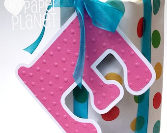 Bright Pink Letter Initial gift tags. Gift wrapping monograms. Embossed  stars, snowflakes, dots or chevrons. Christmas gifts, birthdays.