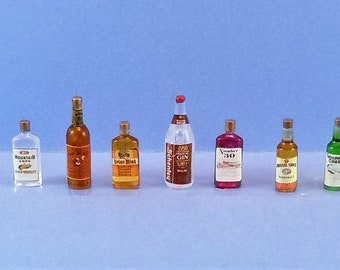 Dollhouse Miniature accessory in twelfth scale or 1:12 scale. Bar accessory.  7-pc liquor bottle set.  Item #D454.