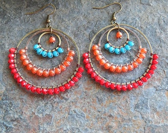 Beaded Hoop earrings - Multicolored big gypsy earrings in red orange and turquoise blue - colorful statement earrings - wire wrapped hoops