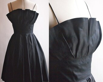 1950's black cocktail dress, heavy taffeta with fitted underskirt and pleated bust line, spaghetti straps., size 10