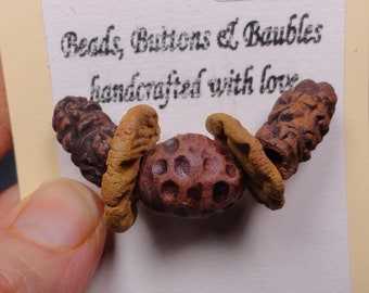 Handmade primitive pottery bead set.