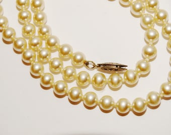 "Sterling Silver 19"" Long marked Clasp Pearl Necklace."