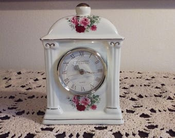 Baum Brothers rose painted ceramic mantle clock