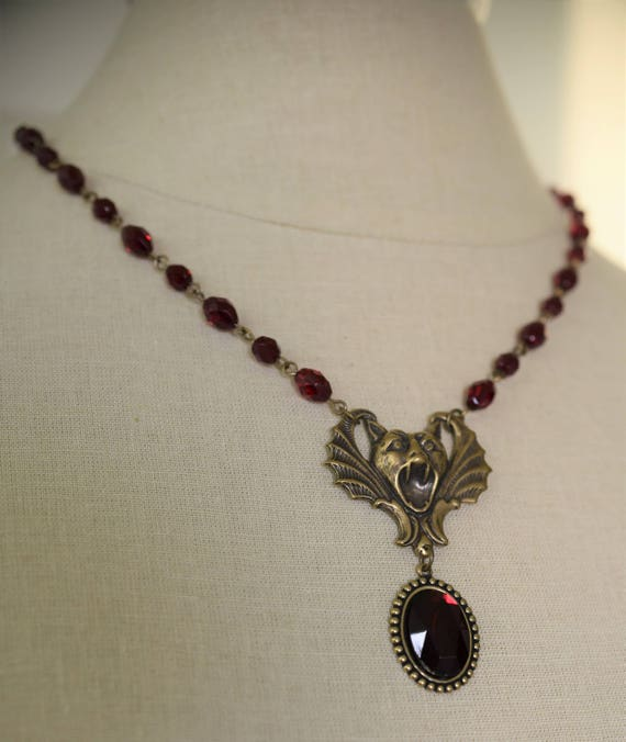 Vampire bat gargoyle pendant and red glass bead necklace aloadofball Gallery