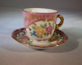 Victoria's Garden tiny tea cup and saucer