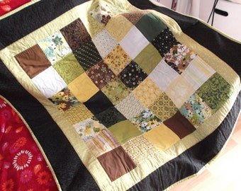 Patchwork quilt using yellow, green, brown and black