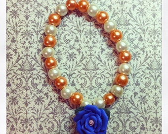 Peach/ivory bracelet with blue clay rose
