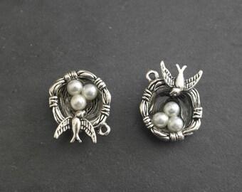 Silver metal bird nest pendant