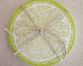 Set of eight lime green letterpress coasters