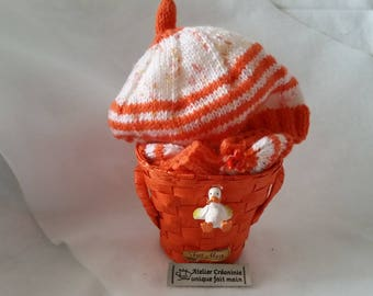 """Hat and baby booties with knitted """"orange and white"""" handmade gift basket"""