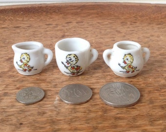 Retro china tea service with image of chick getting ready to clean teeth, tea cup, sugar bowl and jug, miniature.