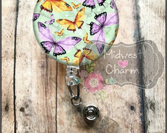 Purple and green butterfly.. Retractable Badge holder nurse, CNA, Teacher, Cook, Secretary, RN, LPN, Xray