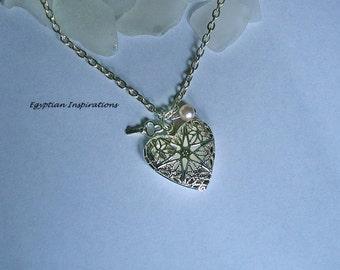 Sea glass heart locket. White beach glass necklace. Beach sea glass jewelry.
