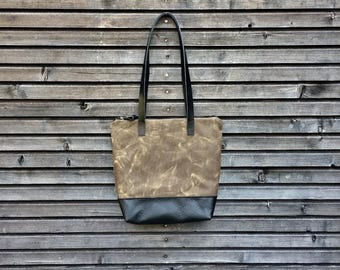 Waxed canvas tote bag with leather bottom,handles and zipper closure