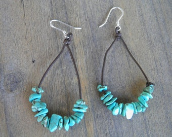 """Earrings... """"Hanging on"""" Turquoise strung on brown leather cord with sterling silver ear wires."""