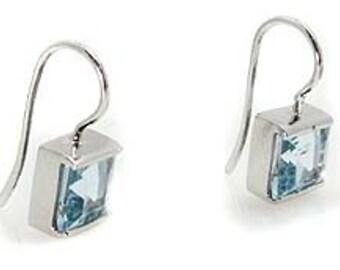 Aquamarine earrings set on white gold .