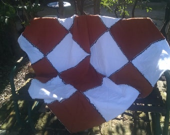Burnt orange and white stadium size rag edge quilt made from recycled T-shirts