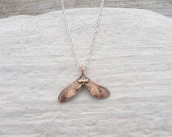 Tiny bronze maple seed necklace