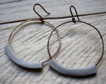 Earrings of copper and leather skin