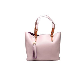 Pale pink leather tote bag with tassel