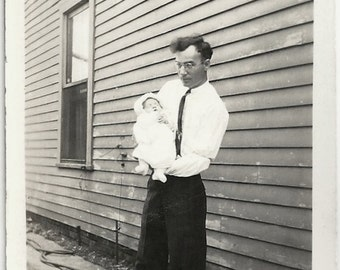 Old Photo Man holding Baby 1920s Photograph snapshot vintage