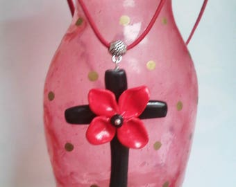 Black cross with red flower pendant