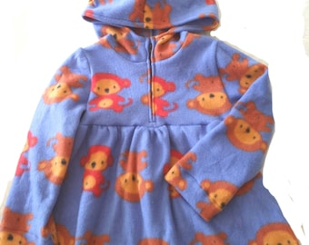 Girl's hooded top in purple with brown and red monkeys. Softly gathered with a zippered yoke. Size 5