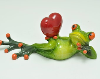 Lounging Frog Holding Heart