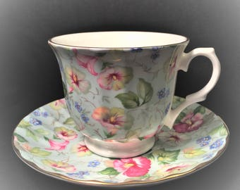 Floral Chintz Crown Trent Fine Bone China Tea Cup and Saucer Made in England, Paneled Sides, Footed Cup, Gold Trim.