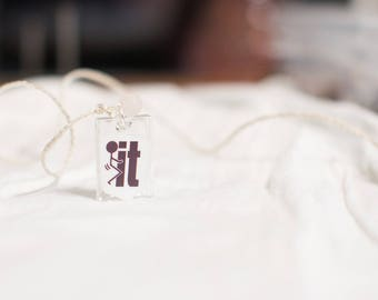 For those days you just don't care. Rectangle F-It resin pendant that says it all.