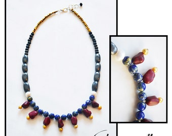 CDC007 - Elegant statement necklace with blue lapis, burgundy howlite, yellow and white pearls, grey hematite, black lava and gold crystals.
