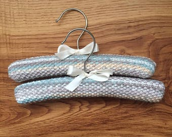 Set of 2 bespoke knitted baby clothes hangers