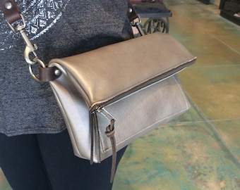 Leather fold over cross body convertible to clutch handbag