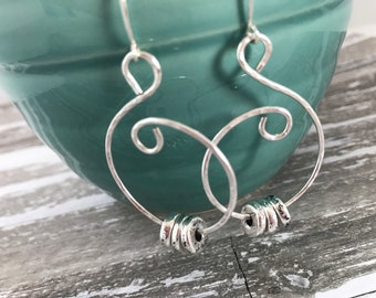 Chloe Silver swirl earrings