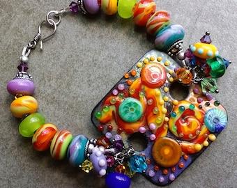 Stunning unique OOAK lampwork bead enamel glass focal bracelet, artisan handmade, bold, whimsical  rainbow modern art jewelry