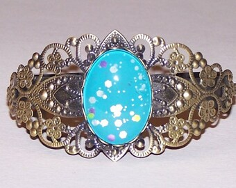 bronze filigree bangle with mermaid scales cabochon