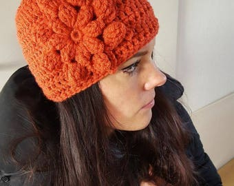 Crochet hat with flower orange
