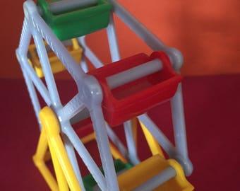 Four Marvi Plastic Carnival Ride Toys