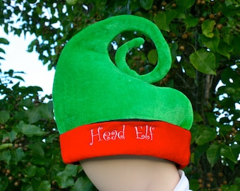 Green and red elf hat that YOU customize! Head Elf.  Santa's helper. Personalize it to say what you want. Or Monogram. Christmas gift.