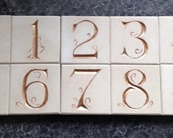 Hand-Cut and Painted House Number Plaques in Portland Stone