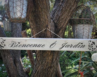 """Weathered wooden """"Welcome O Garden"""" sign"""