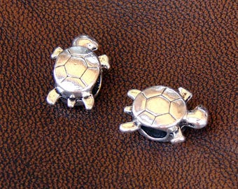 6 turtle round leather or cord, antique silver spacer beads