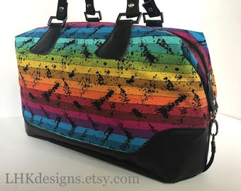 Rainbow Brooklyn traveler bag or purse with faux leather accents and yellow polka-dot lining
