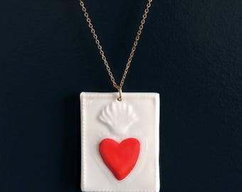 Medallion 'Heart' red glazed porcelain, hand painted.