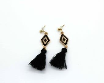 diamond shaped dangle earrings with tassels