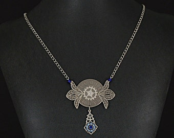"""Unique Clock faced """"time flies"""" necklace with vintage filigree wings, blue beads and crystals by Sylvan Creations"""