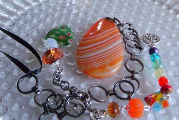 Bright orange sun catcher - rainbow colors - LGBT -  green floral heart - rainbow bridge sun catcher - memory gift - pride -  peace charm
